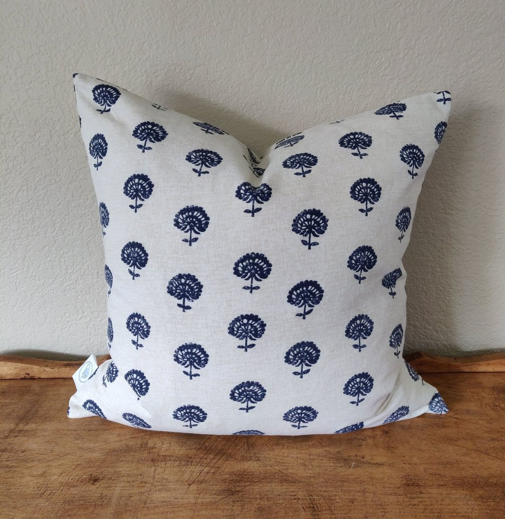 """Flora - Delicate floral print on ivory cotton. Constructed with in invisible zipper. Wash and dry medium.18"""" x 18"""" - $34 and 14"""" x 20"""" - $32Colors: navy on ivory"""