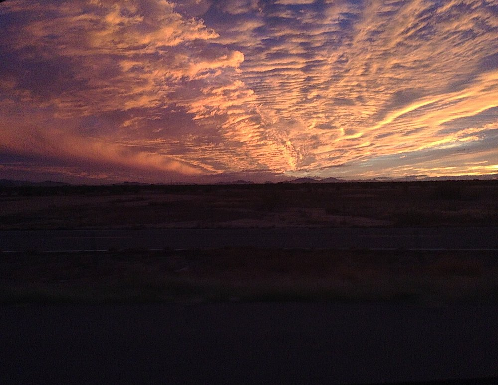 Hi, overwhelmingly gorgeous desert sunset (as seen from my points-paid-for rental car).