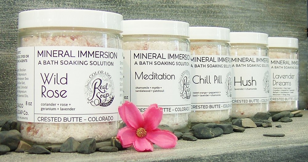 - MINERAL IMMERSIONS: Bath Soaking Solutions.  A variety of mineral salt blends for soaking away aches, pains & itch . Enhanced with wild medicinal flowers and leaves, and essential oils.