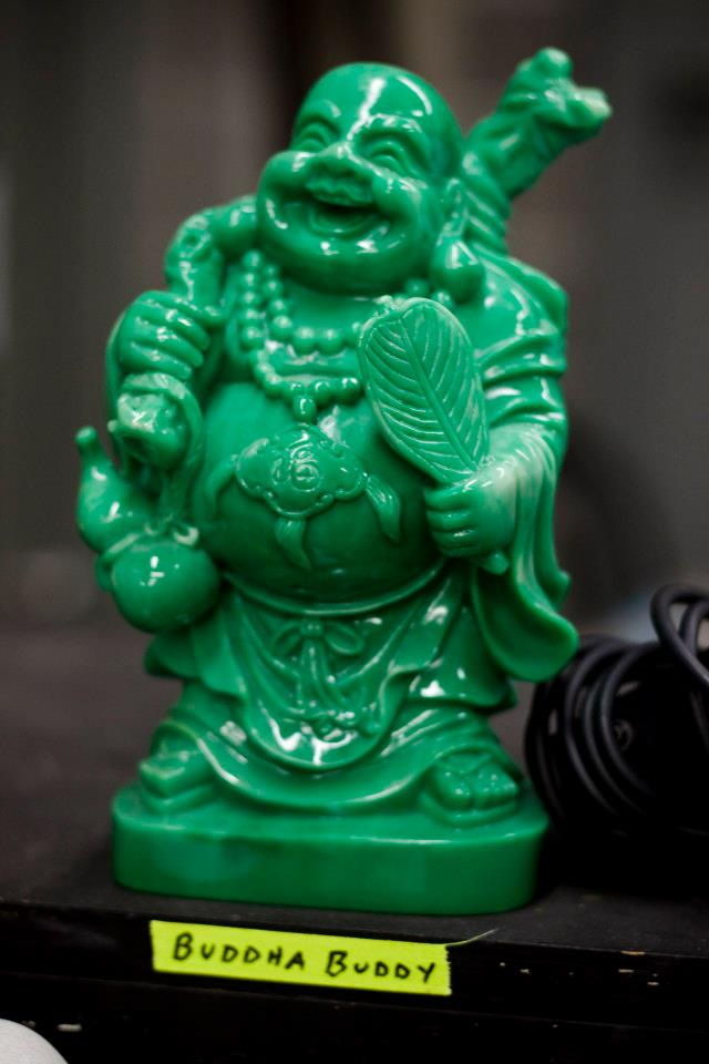 Buddha Buddy hanging out a prop table in rehearsals. Don't think he appeared in the show. Don't recall seeing him after rehearsals. Love him anyway.  Photo Credit - Tracy Davis