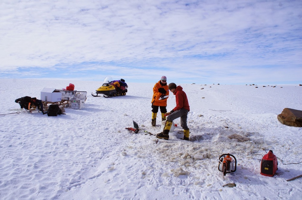 Collecting ice samples from debris bands on the blue ice