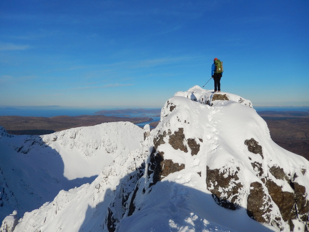 Joris on the summit of Gillean, rest of the ridge ahead of us