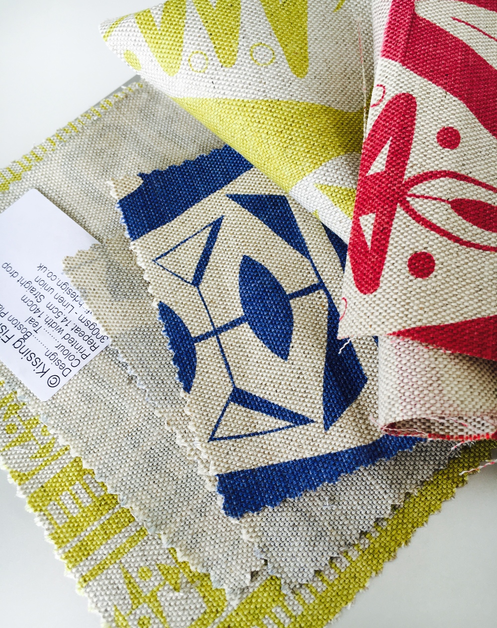 Shown here are 'Boston Place' and 'Dorset Square' designs in Bitter Lime, Blue and Red