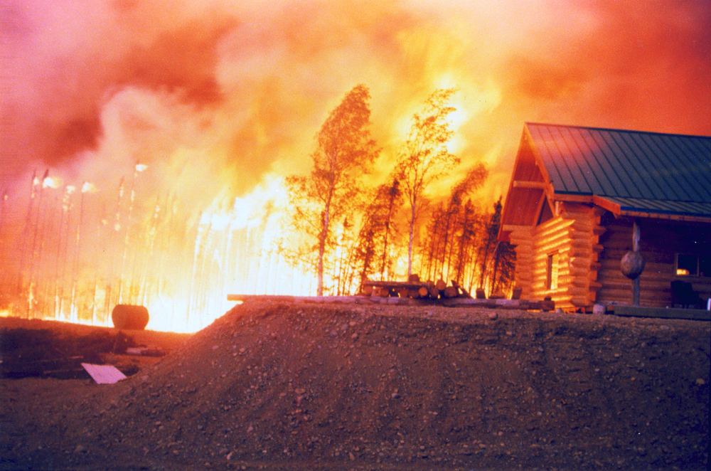 A home in the glow of the Miller's Reach Fire. Photo courtesy of the Matanuska Susitna Borough Emergency Services.