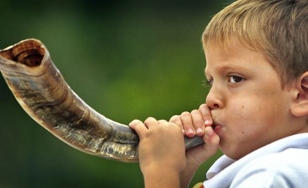 child blowing shofar.jpg