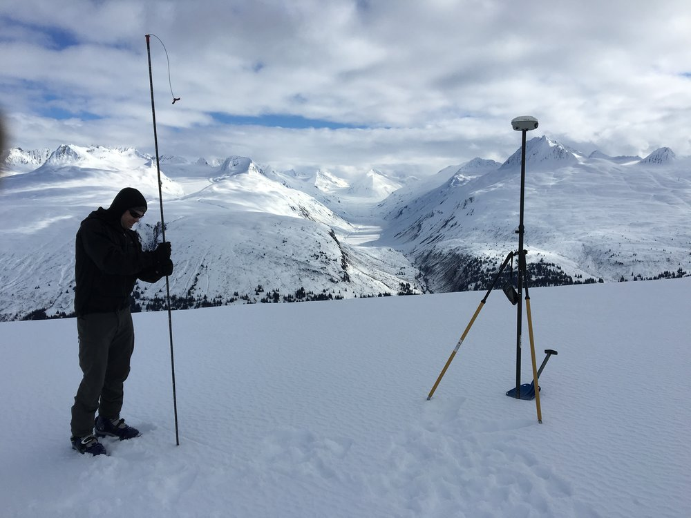 Dr. Gabe Wolken does a probe strike to test snow depth near a remote weather sensor in the Eastern Alaska Range. (Photo by Alex Gould)