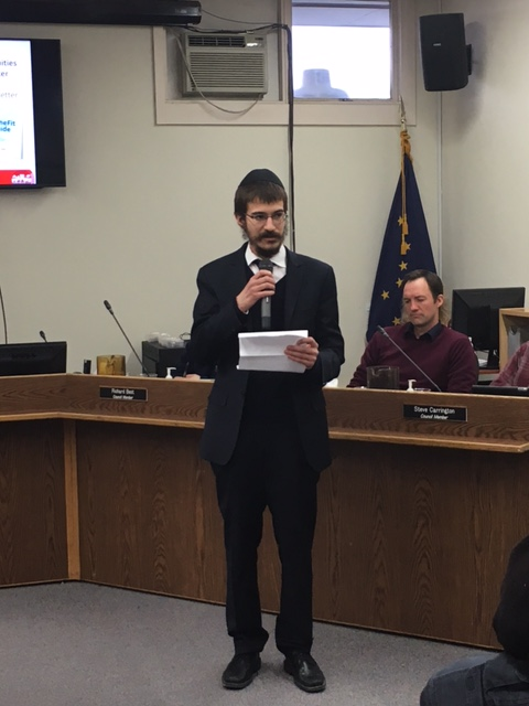 Rabbi Mendy giving his speech at the city council meeting.