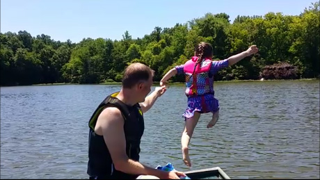 Avery jumping in the lake to practice her preparedness skills. Photo by Debra McGhan.