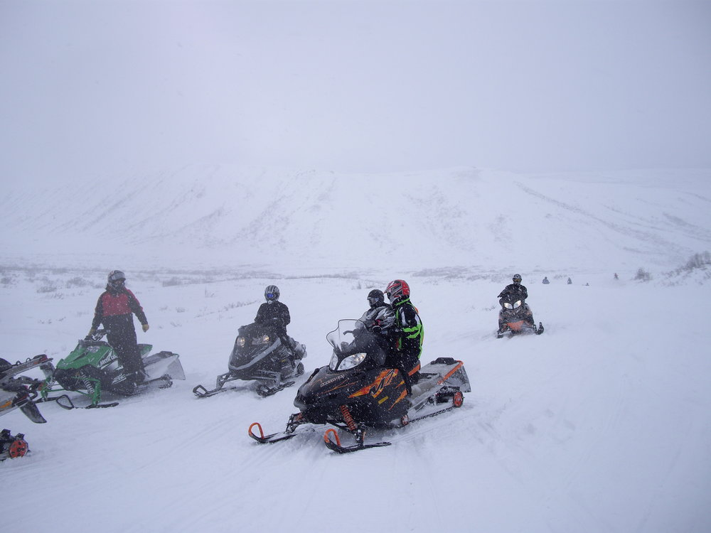 A group of riders stop to discuss conditions. Photo by Debra McGhan