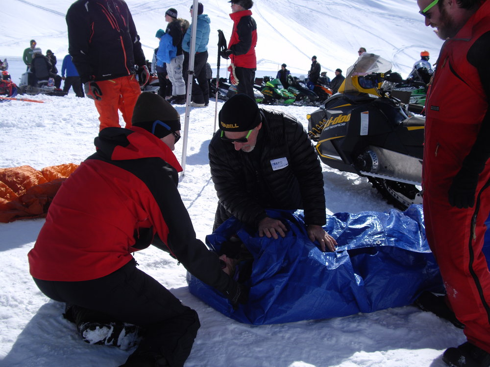 Instructors demonstrate proper care for a hypothermic victim in the field. Photo by Debra McGhan.