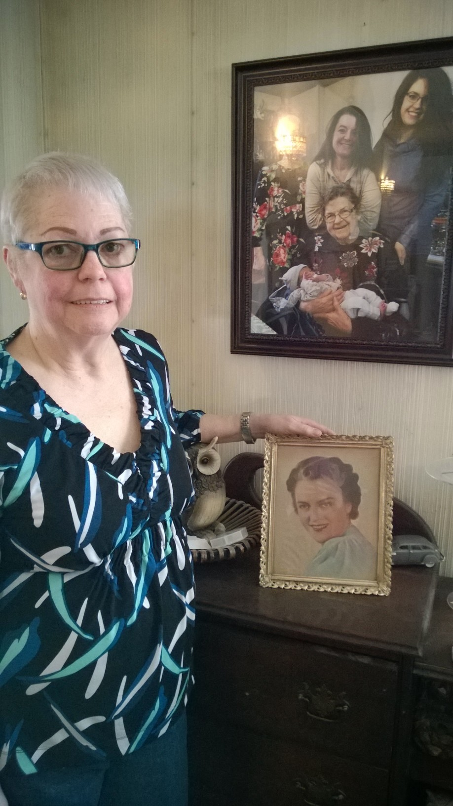 Daughter, Peggelee Kendro, with her mother's favorite family photo of five generations on the wall and her mother's mother who abandoned Pegge in a hotel room at age 4 before she was found a week later.