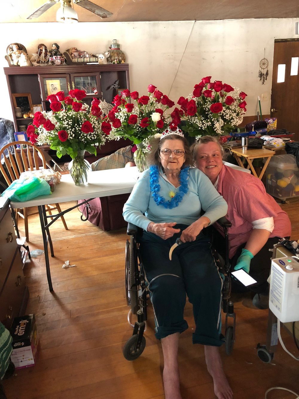 Pegge McDonald with her Hospice Home Health Aide, Jenny Klink, on Pegge's 92nd birthday, February 21. The 92 roses were sent by her son, Kelly Michael Christensen.