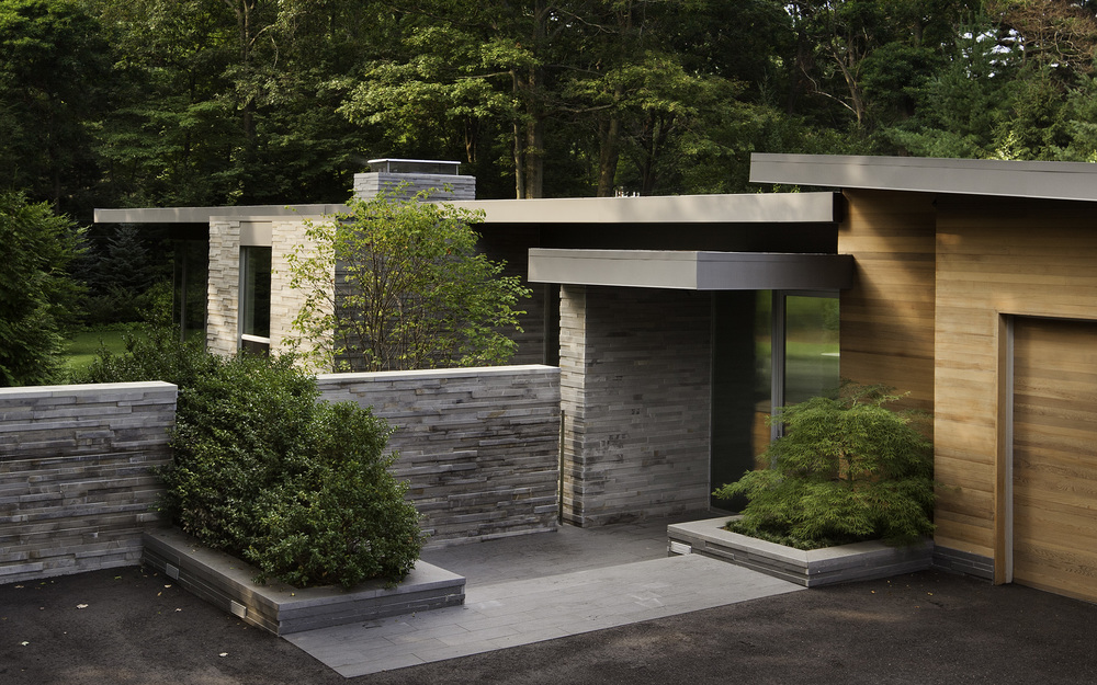 Entry with Cedar-Clad Original House meeting Stone and Glass Pavilion