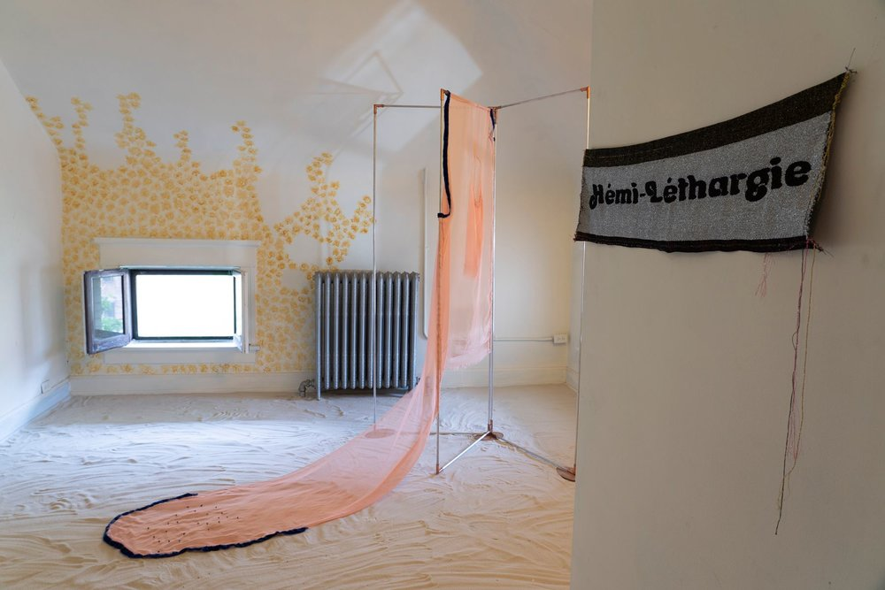 The Perplexity of growth or Stagnation  by CV Peterson (wall);  Rebecca  by Yvette Brackman (center);  Hémi-Léthargie  by Verónica Casado Hernández (right); remnants of  Score for Sand and Foil  by Andrew Bearnot (floor)