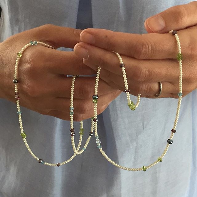 June's 'pearls of wisdom' longline seed pearl and mixed stone delicate summer necklace😊 . . . . . #junesbirthstone #seedpearls #delicatenecklace #summer #peridot #garnet #apatite #greypearls #longline #june #necklace #birthstone