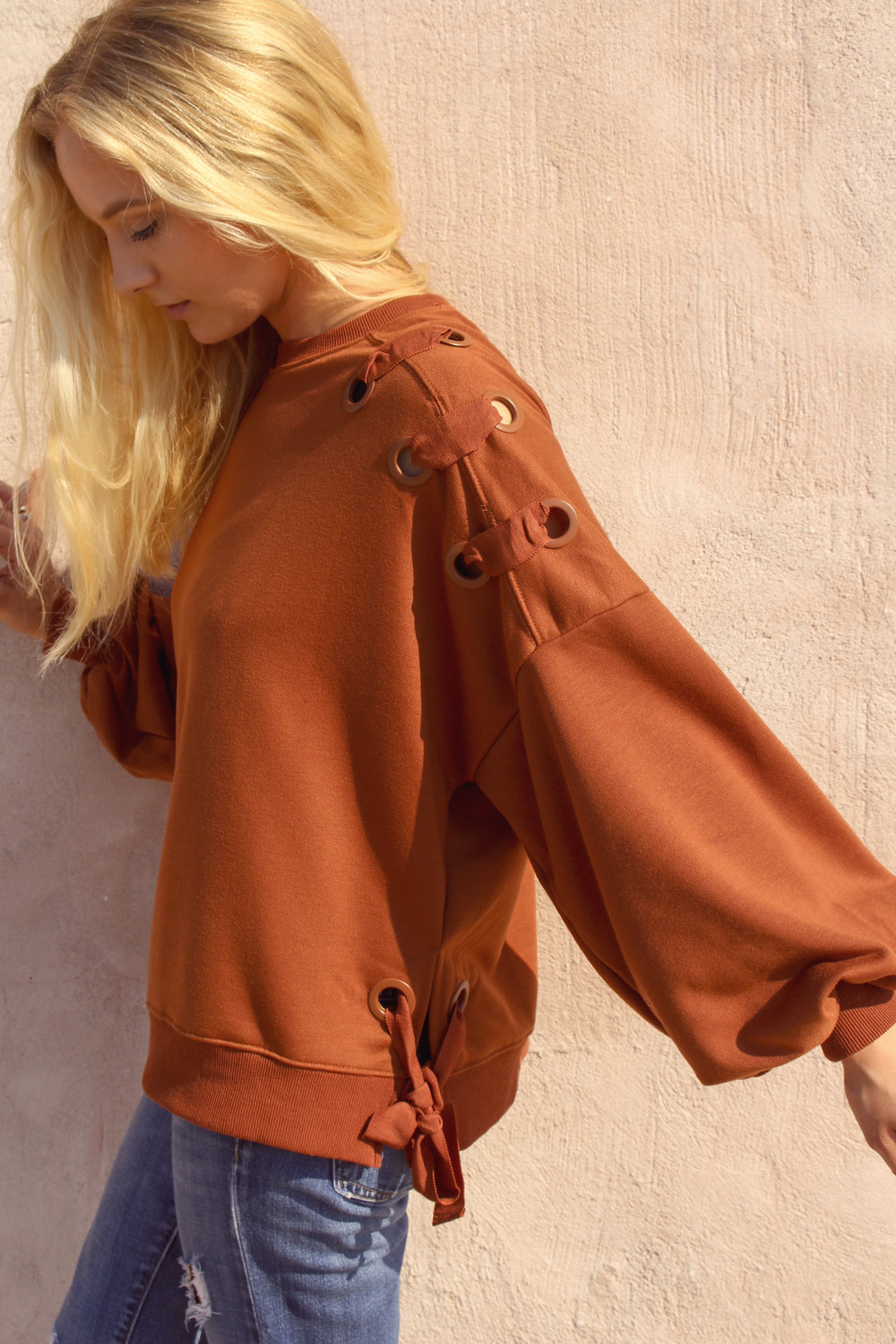 rust lace-up sweatshirt {$48} <br> I'm wearing a small