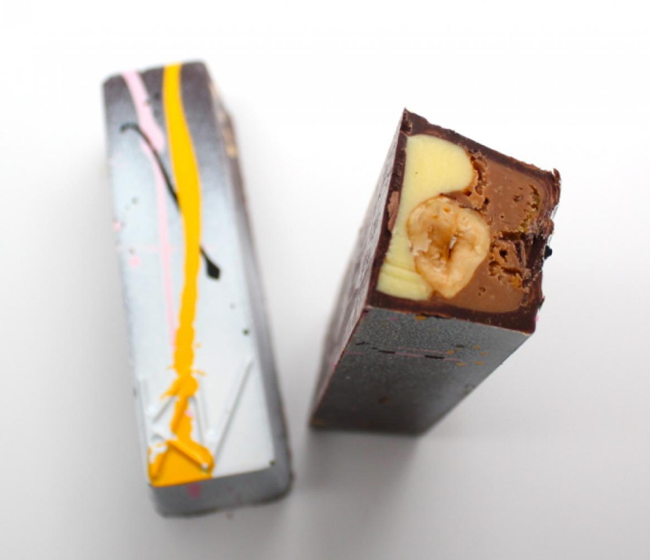 A beauty shot of Kate Weiser's handcrafted Passion Praline candy bar.