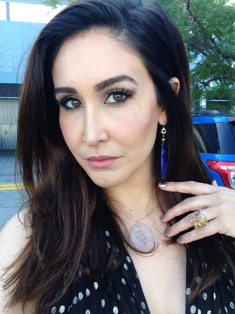 Suz Marques rocking an infinity rose quartz ring, a gold Montana Lace Agate pendant and Lapis earring.