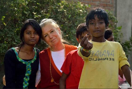 Swami Ambikananda, YogaBen's teacher and founder of the Traditional Yoga Association and Mukti, shares time with children the charity has helped.