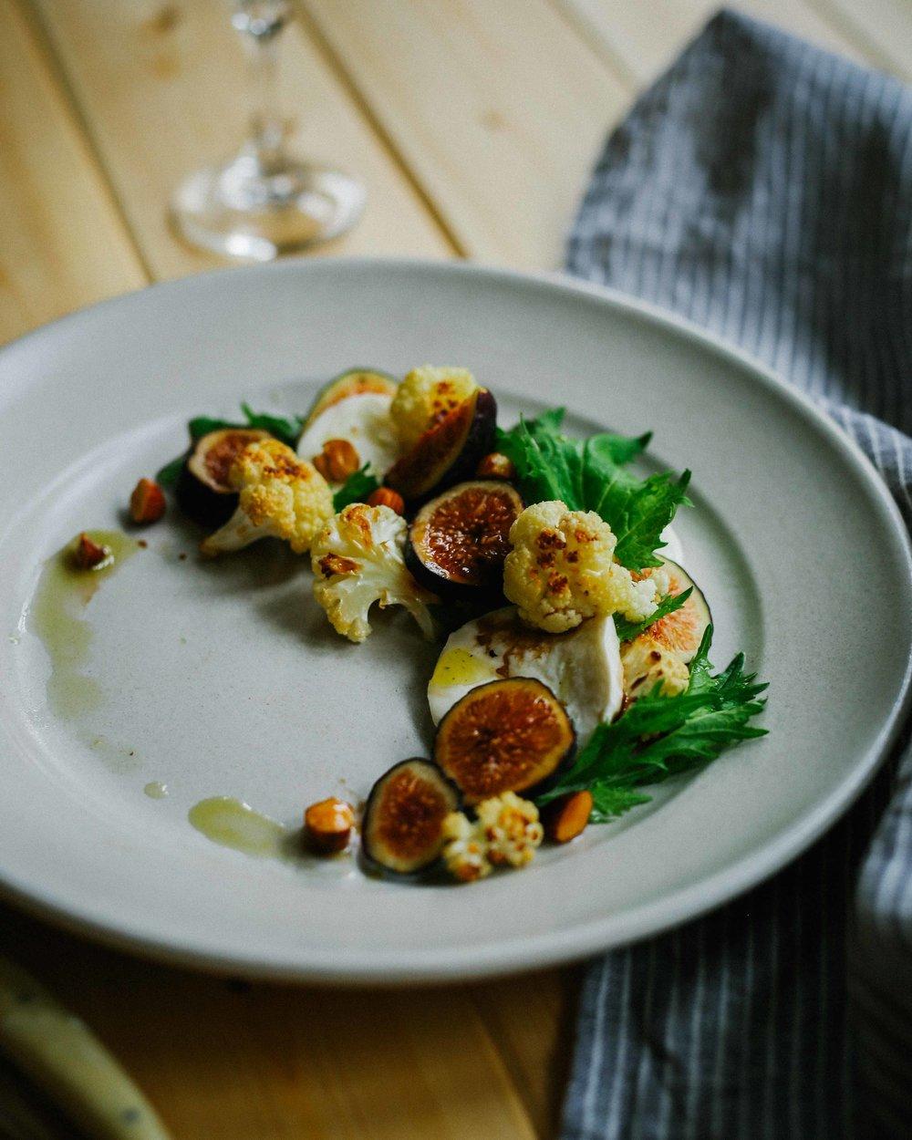 roasted cauliflower with figs, burrata, mizuna, and almonds