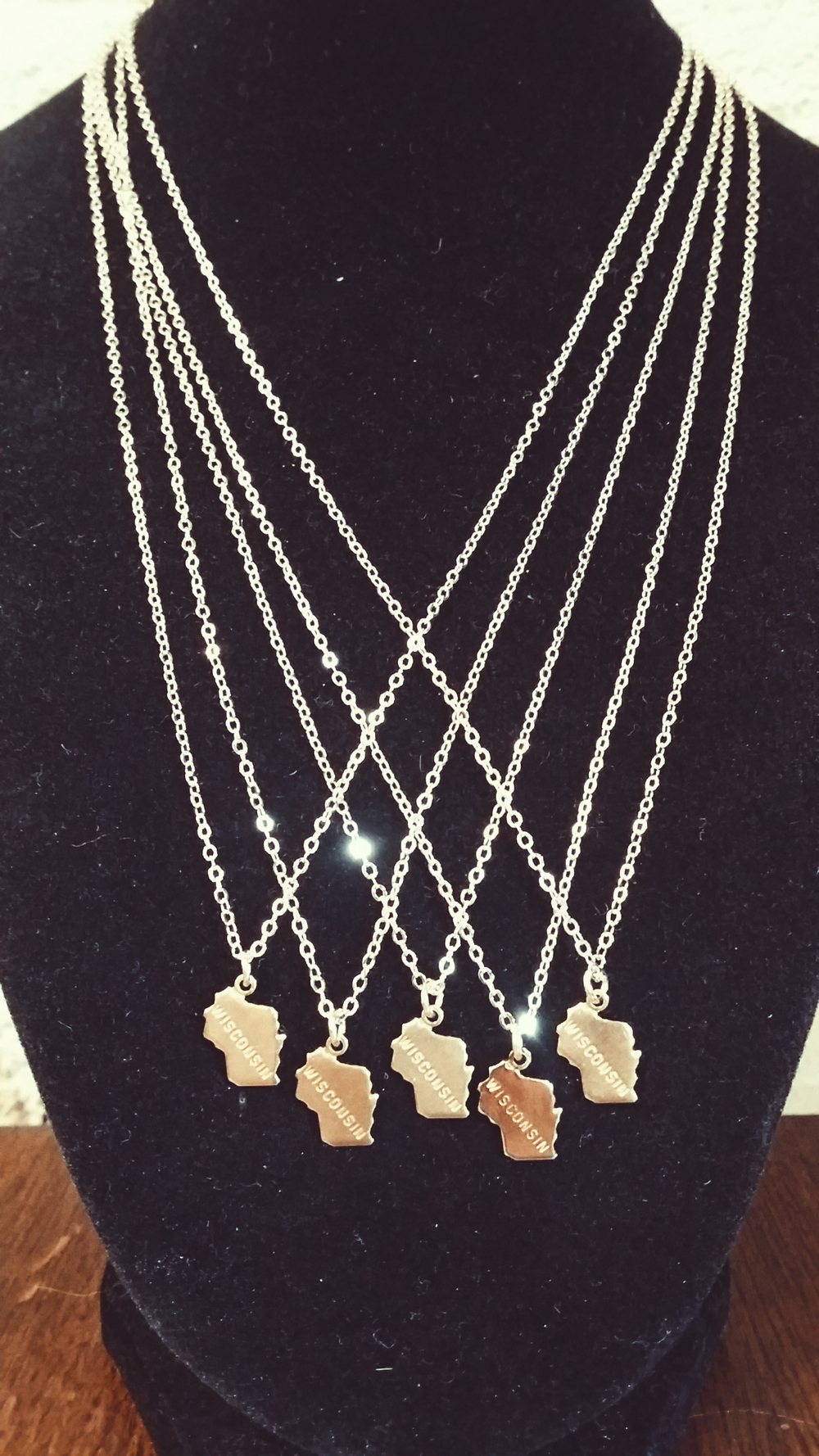 Native or not, keep a little piece of Wisconsin close to her heart. Delicate and gold-plated and $18 each.