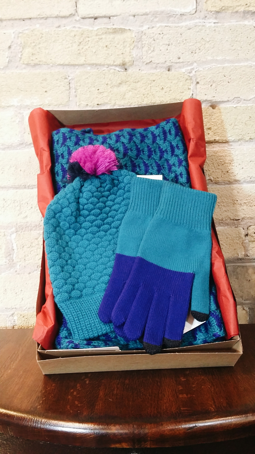 A knitwear box from Verloop is the essential gift that you know won't get lost on a closet shelf! These cozy knits come in several different vibrant and neutral shades and are great for mixing and matching. Gloves: $36. Hat: $32. Scarf: $58.