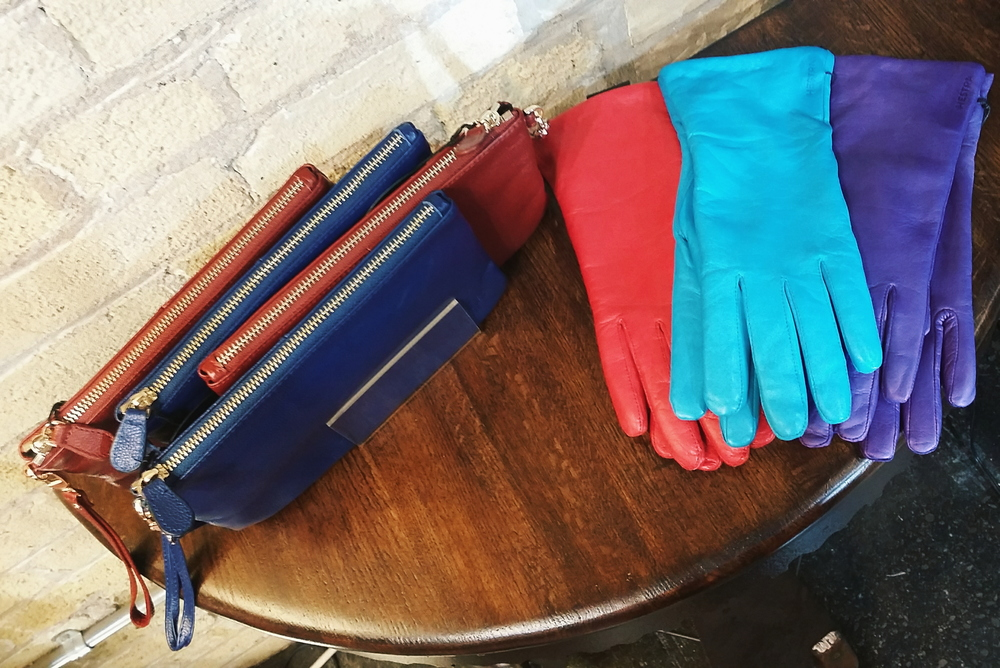 For the hands-on woman: brightly colored Hestra gloves are made with the softest leather to keep her hands warm this Winter. $100 each. If she finds herself in a pinch more often than not, Mighty Purses feature a portable phone charger for mid-day emergencies. $98 each.