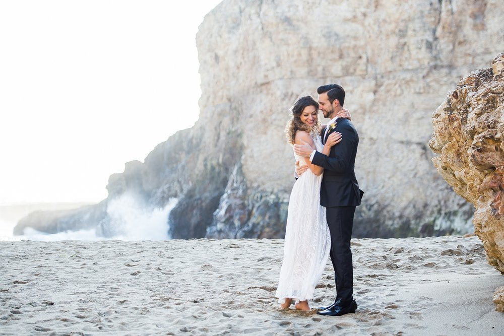 Adventurous elopement and intimate wedding at Shark Fin Cove in Northern California. Beautiful beach wedding ceremony on the rocky coast near Big Sur.