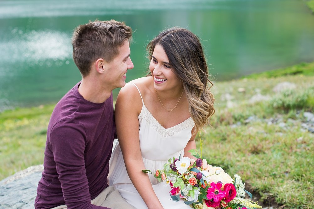 Colorado adventure wedding in the San Juan Mountains. The adventurous couple took a jeep up to Clear Lake, a beautiful green lake near Silverton and Ouray CO.
