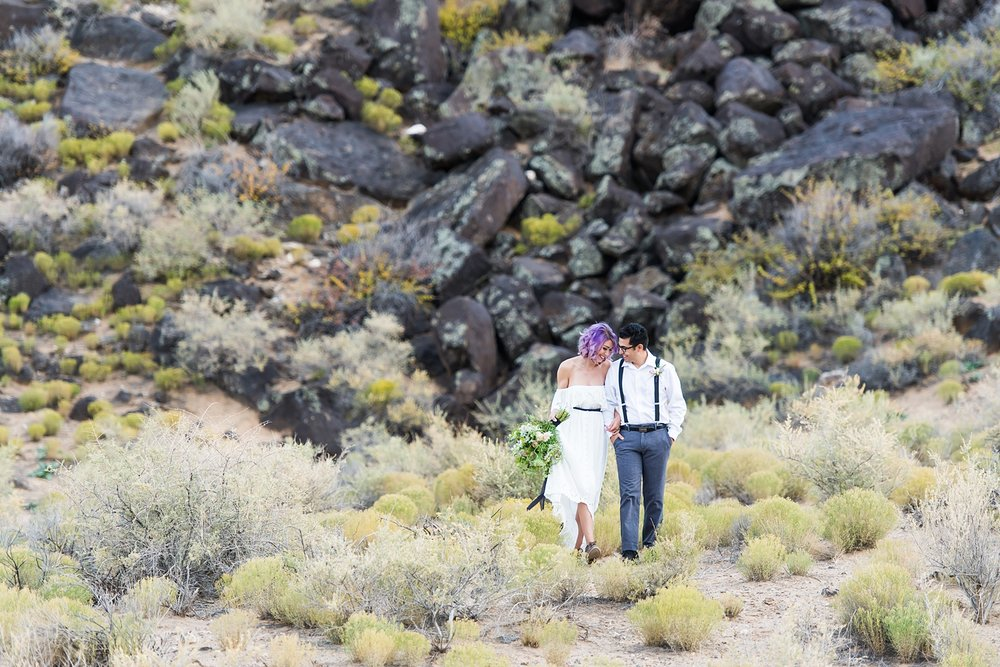 Elopement in the New Mexico with sage, lava rock, and desert landscape. The perfect location in Albuquerque near the volcanos to elope.