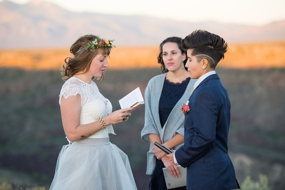 Adventurous elopement on the canyon edge of the Rio Grande Gorge in Taos, New Mexico. The couple said their hand written vows and poetry as the sun set in the southwest desert.