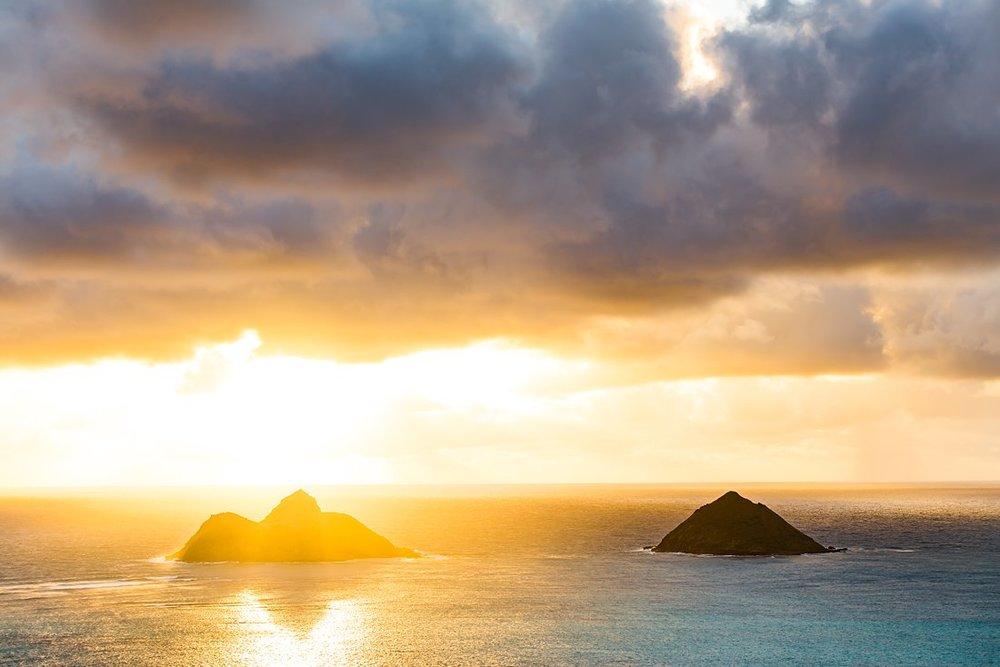 Sunrise over Mokulua Islands near Lanikai Beach Oahu, Hawaii