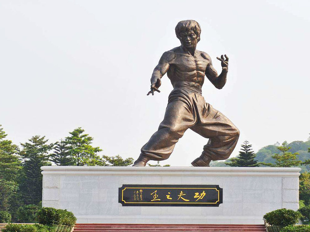 Bruce Lee Statue - There is a biggest Kung fu bronze statue in the world - Bruce Lee, which is located in Shunde, China. Its size is 18.8 meters height and was made of casting bronze with patina finish. Professor Cao Chongen was invited by Bruce Lee Memorial Hall to design Bruce Lee statue to commemorate the 70th anniversary of his birth. Read More →