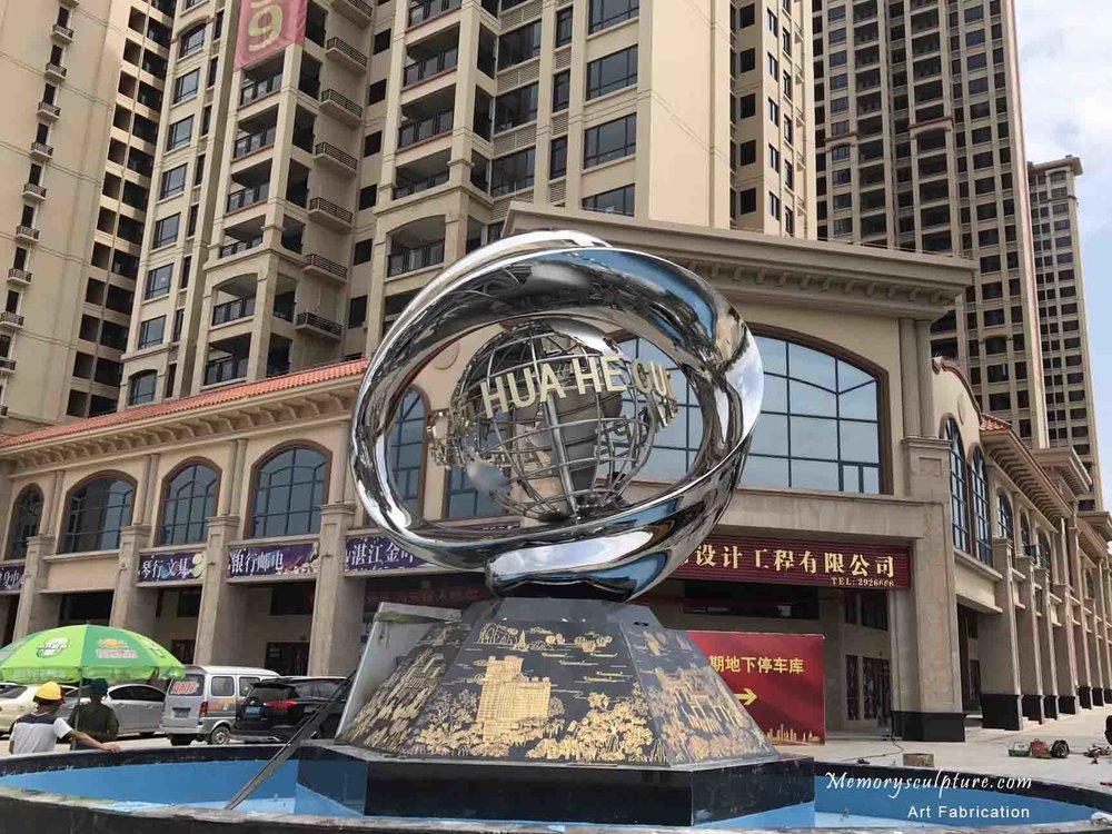 stainless steel globe sculpture