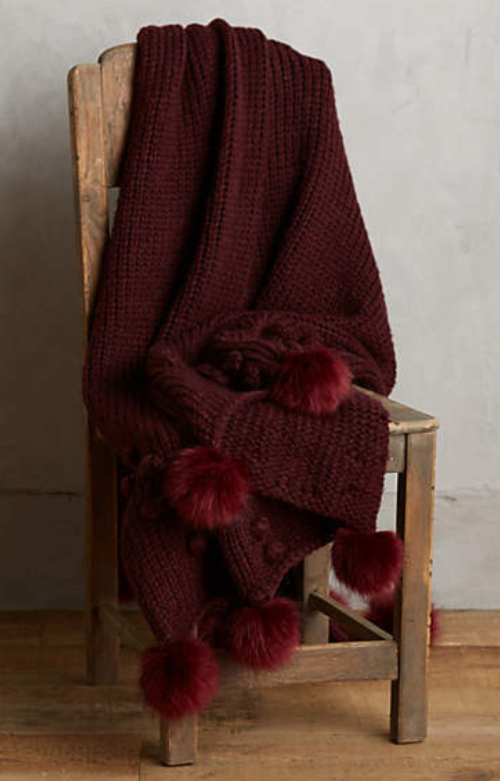 Snuggle up by the fire with this cozy throw blanket.