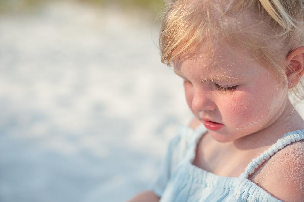 girl with sand-Pensacola beach family photographer