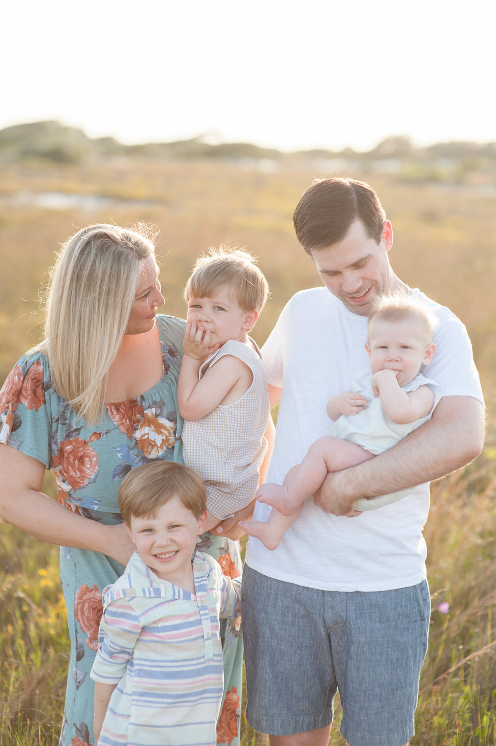 mom and dad with 3 boys at beach- Pensacola Beach Family Photographer