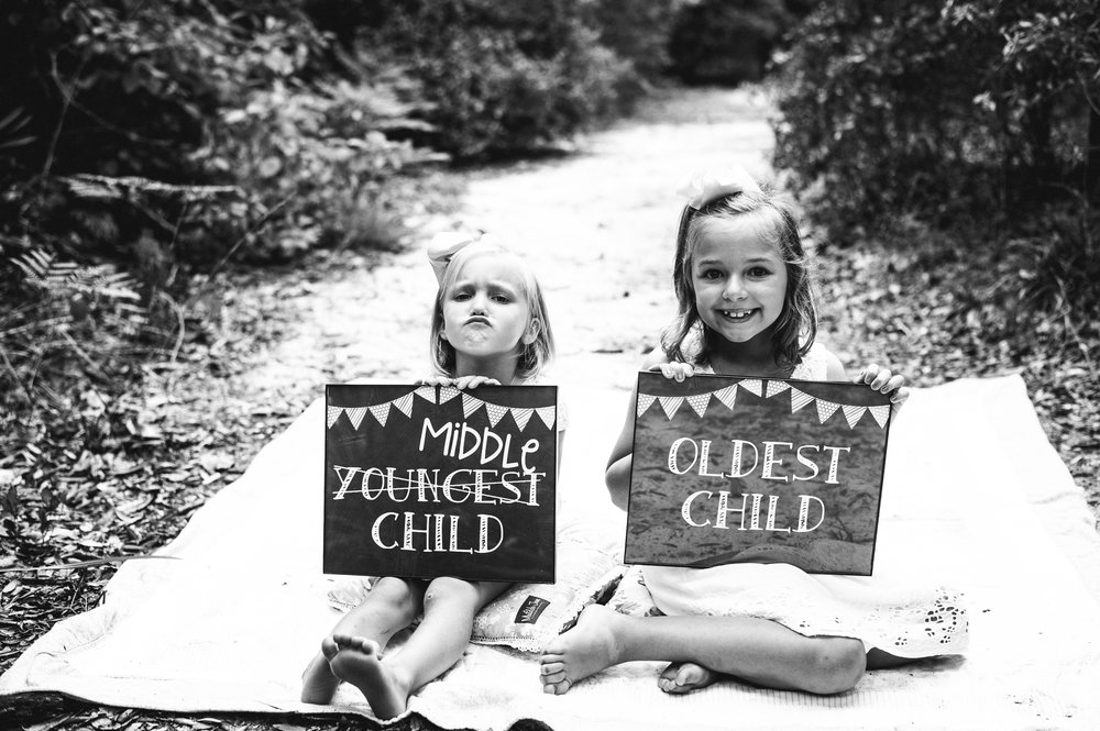 two girls with sign in hands-Gulf Breeze Child Photographer