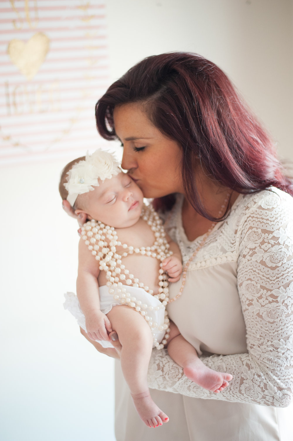mom kissing baby-Pensacola Newborn Lifestyle Photographer