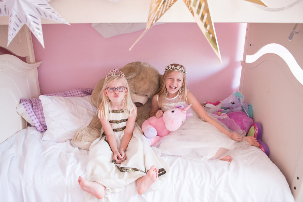 sisters on bed- In-home Pensacola Photographer