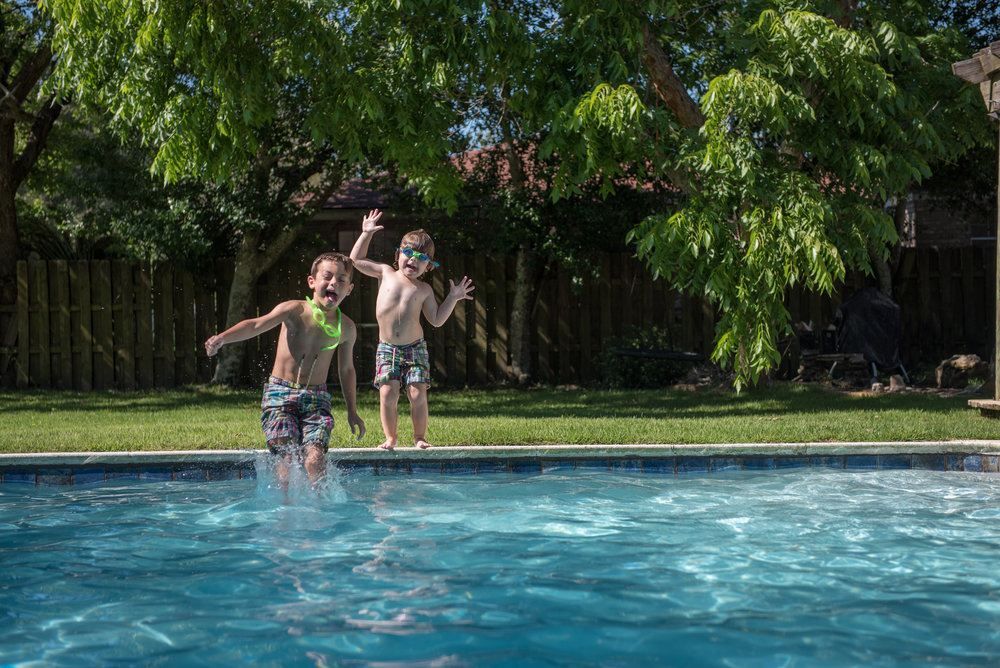 boys jumping in pool- Gulf Breeze Lifestyle Photographer