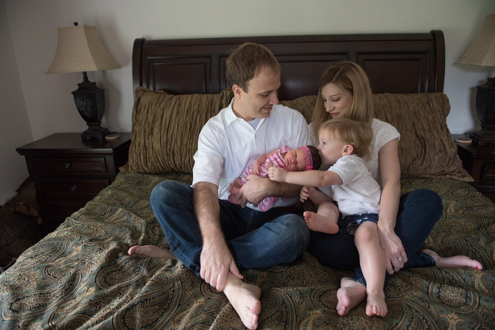 family on bed-Pensacola Newborn In-home Lifestyle Photographer