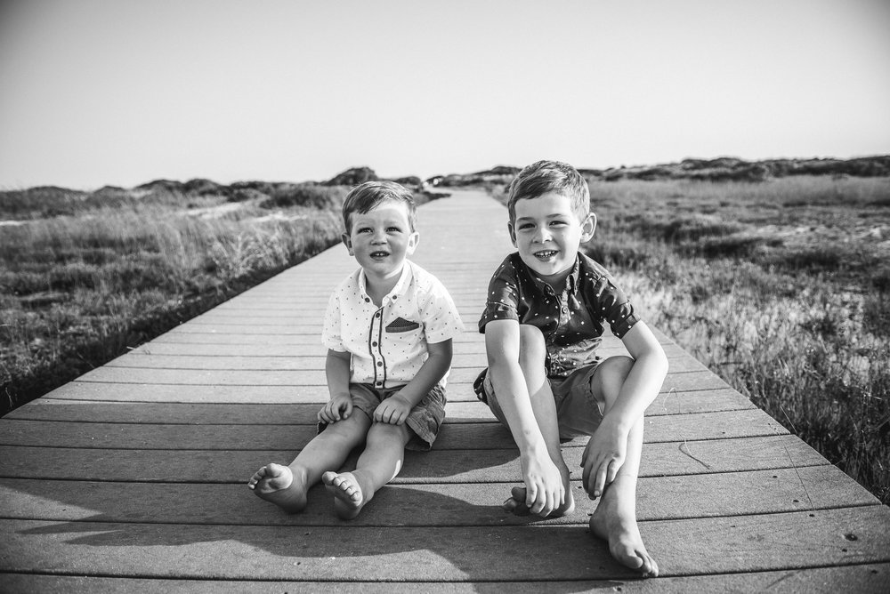 boys on boardwalk-Pensacola Beach Family Photographer