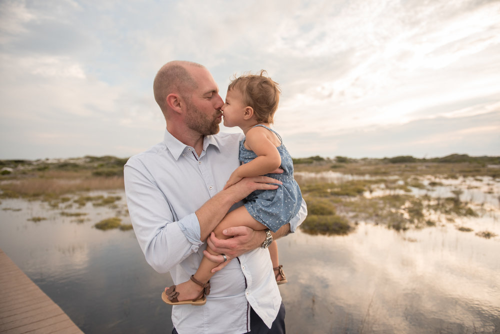 dad and daughter kissing- Pensacola Beach Family Photographer