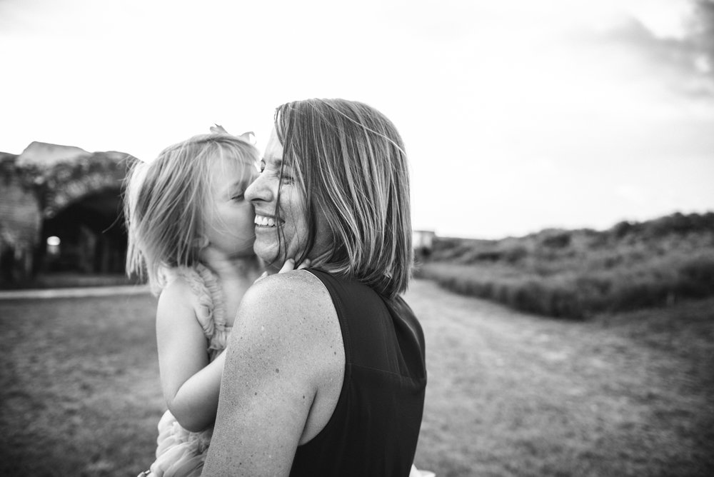 daughter kissing mom- Pensacola Family Photographer