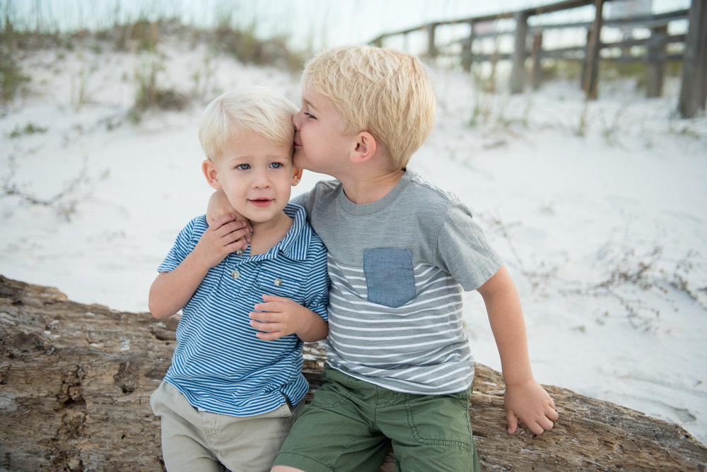 two boys hugging on log-Pensacola Children Photographer