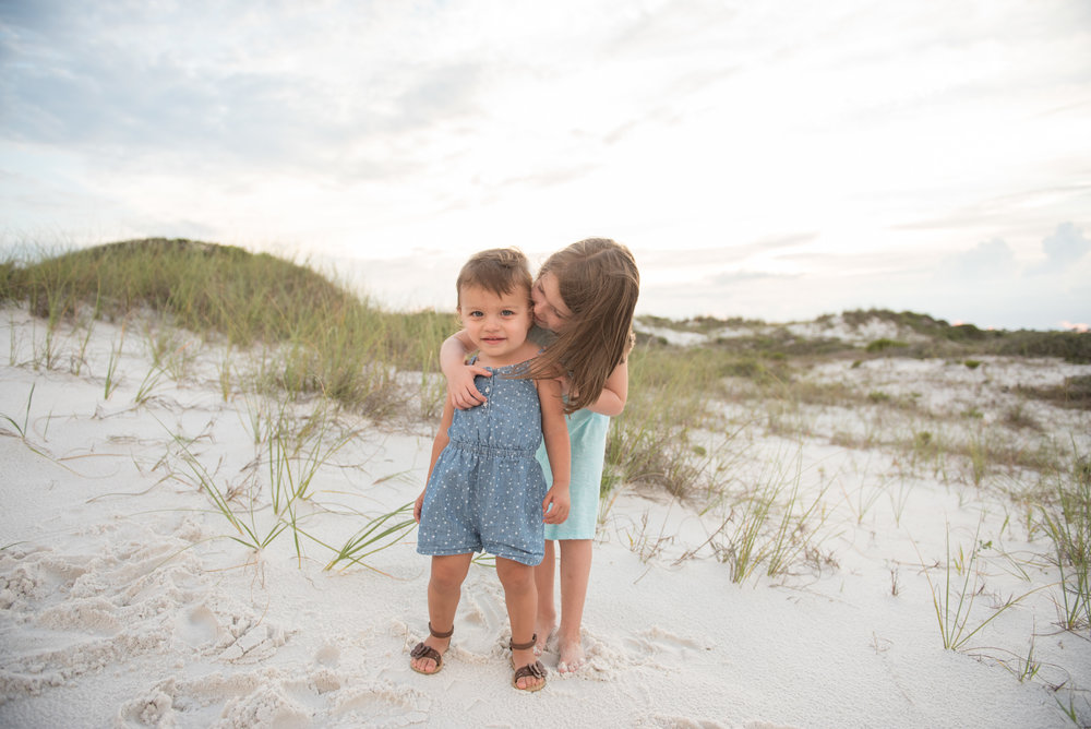 two sisters by dunes-Pensacola Beach Children Photographer