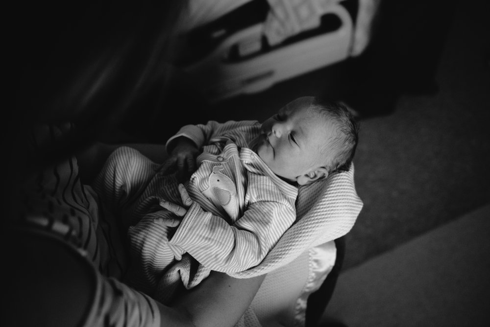 newborn in lap-newborn-pensacola photographer