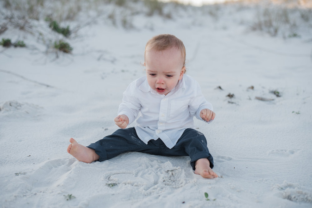 baby digging in sand- Gulf Breeze child photographer