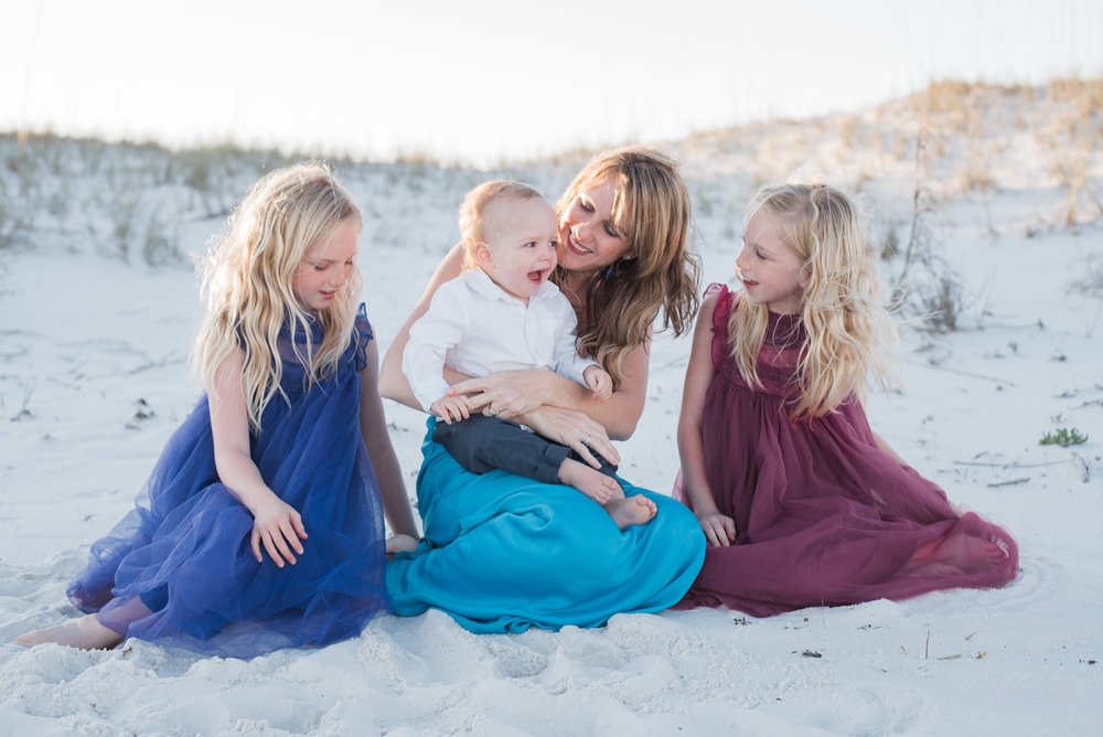 girls looking at baby-Pensacola beach family photographer